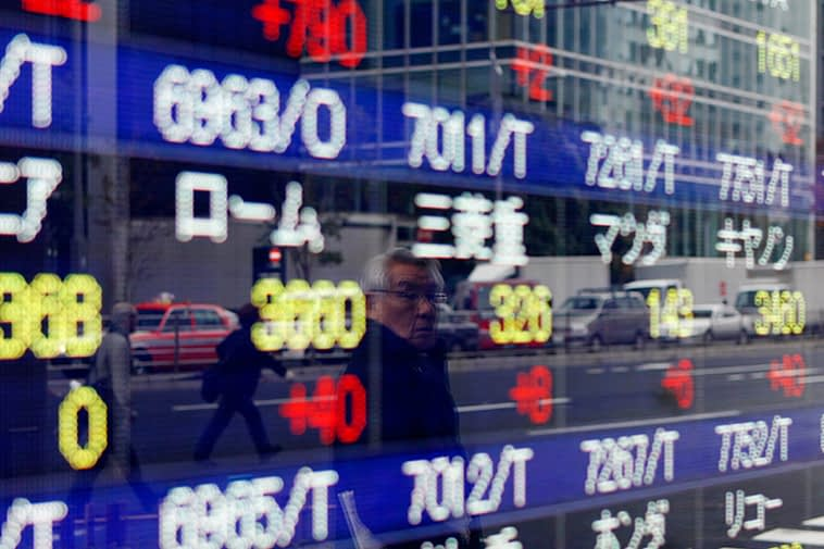Asian Stocks Up, Boosted by Commodity Rally, Record Finish in U.S.